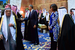 President Obama and First Lady Michelle Obama, joined by the new King Salman of Saudi Arabia, shake hands with members of the Saudi Royal Family at the Erqa Royal Palace in Riyadh, Saudi Arabia, on January 27, 2015, as they, U.S. Secretary of State John Kerry and other dignitaries extended condolences to the late King Abdullah and call upon and met with King Salman. [State Department photo/ Public Domain]