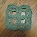 Small photo of Celtic knotwork crochet trivet