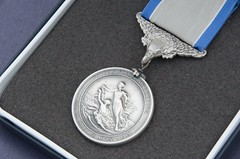 locket(0.0), money(0.0), currency(0.0), pendant(0.0), award(1.0), silver(1.0), medal(1.0),
