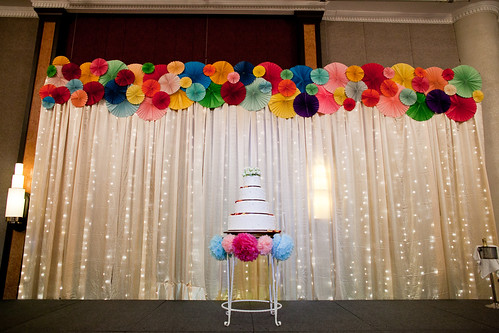 I Love Our Backdrop Have Never Seen Anything Like This For A Hotel Wedding The Fairy Lights With Soft Fabric Colourful Pinwheels And Poms