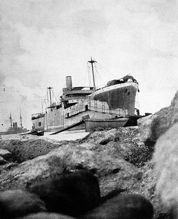 River Clyde at V Beach on the Gallipoli peninsula, showing disembarkation ports cut in her starboard side.