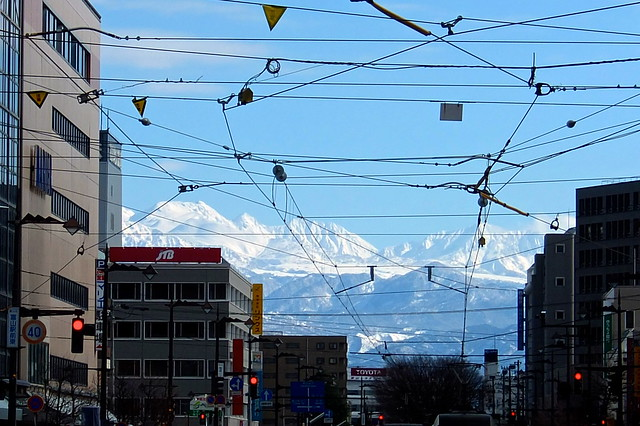The mountains over the overhead wire