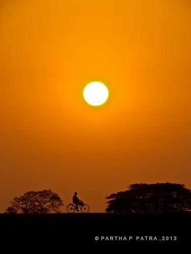street sunset people silhouette cyclist bhubaneswar odisha