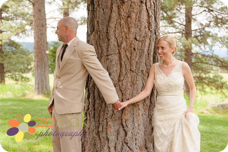 Bride and Groom hold hands moments before their first look at their Seeley Lake Wedding in Montana.