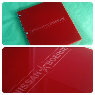 Custom portfolio book in red acrylic with engraving treatment for Nissan