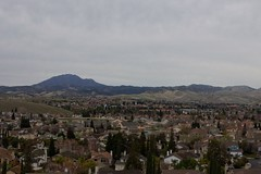 Klaus Naujok posted a photo:	Another view of my neighborhood, towards Mount Diablo and Jack London School, from the water tower hill. Photo taken with the Konica Minolta AF DT 18–70mm @ 35mm (52mm FF).