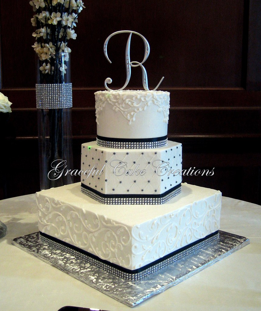 Elegant White Wedding Cake with Black Ribbon and Bling - a photo on ...
