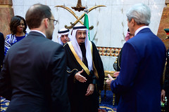 U.S. Secretary of State John Kerry greets the new King Salman of Saudi Arabia at the Erqa Royal Palace in Riyadh, Saudi Arabia, on January 27, 2015, after joining President Obama, First Lady Michelle Obama, and other dignitaries in extending condolences to the late King Abdullah. [State Department photo/ Public Domain]