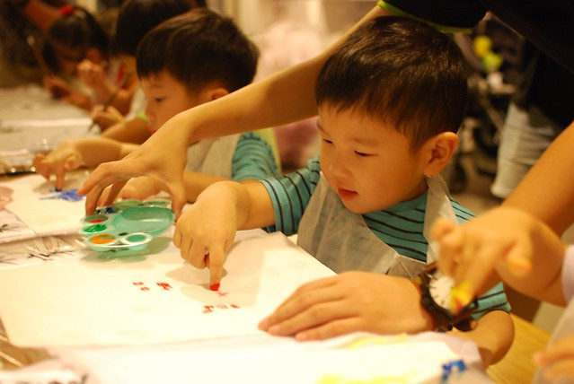 Happy Jerome, finger painting his first art work.