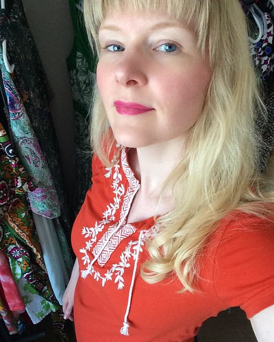 Wearing orange today. What color lips go with orange? Pink it is.