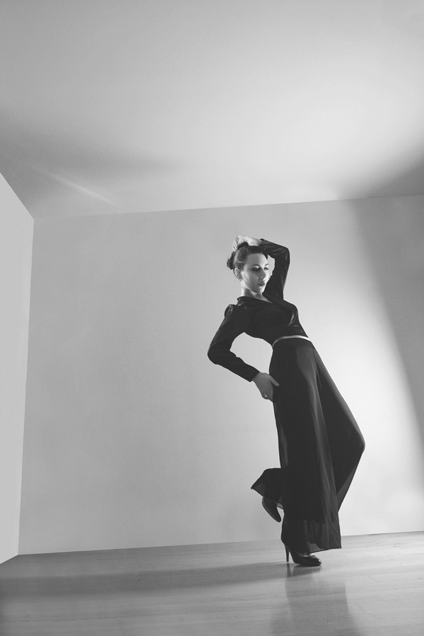 Gestalta photographed by Rebecca Tun. geometric image of statuesque black clad woman