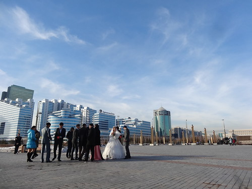 A bride and her party out on a windy March day in Astana, Kazakhstan