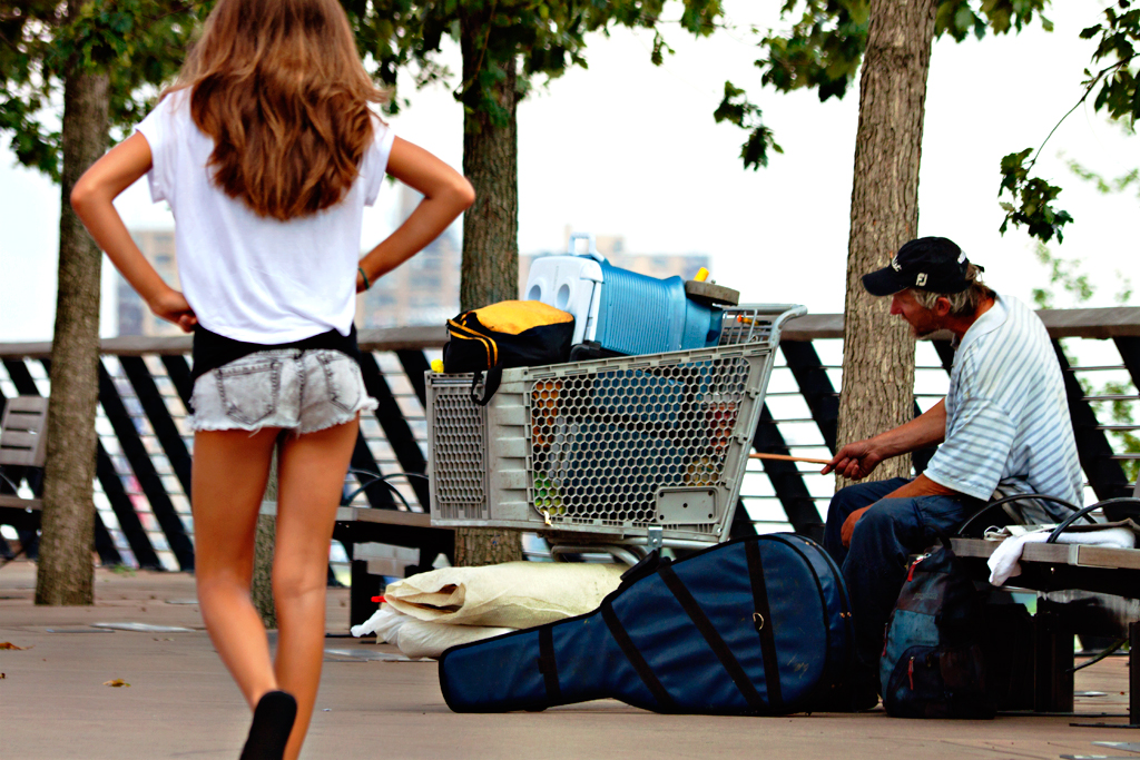 Man-banging-on-shopping-cart--by-Delaware-River
