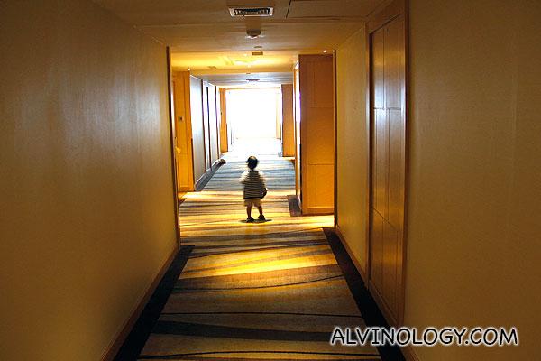 Asher exploring the rooms corridor