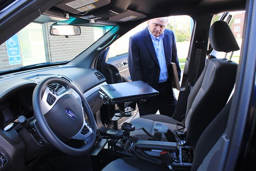 Indiana USDA Rural Development State Director Philip Lehmkuhler inspects the equipment in Jasonville's new police vehicle.