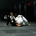 <p>Rafael Lovato Jr. works an omoplata vs Professor Adam Ryan during a June 2011 seminar at Dynamic Mixed Martial Arts in Richmond, BC, Canada. <br /> <br /> Copyright Jeff Chan at JiuJitsuVortex.com.</p>