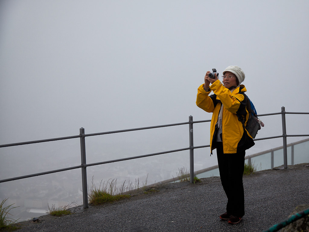 Japanese woman (with camera) in fog
