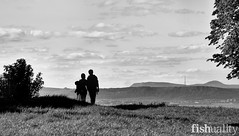 Tourists silhouetted on Calton Hill with the mast at Burntisland and West Lomond in the distance...