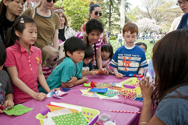 Kids join in the Spring Pinwheel Workshop led by the staff of Curious Jane. Photo by Mike Ratliff.