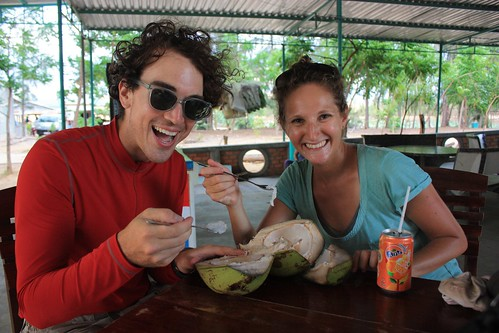 Enjoying our coconut after walking around the sand dunes
