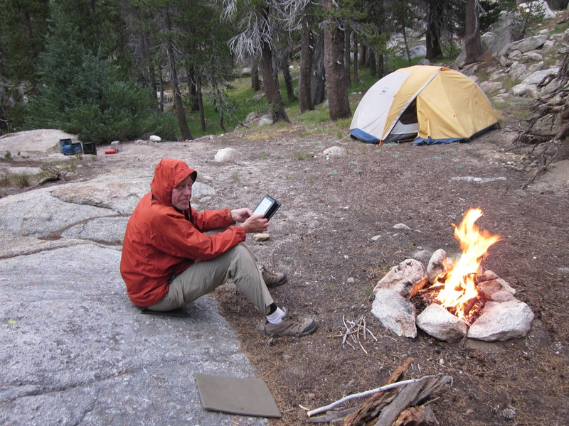 Relaxing and reading by the campfire in our campsite in Matterhorn Canyon