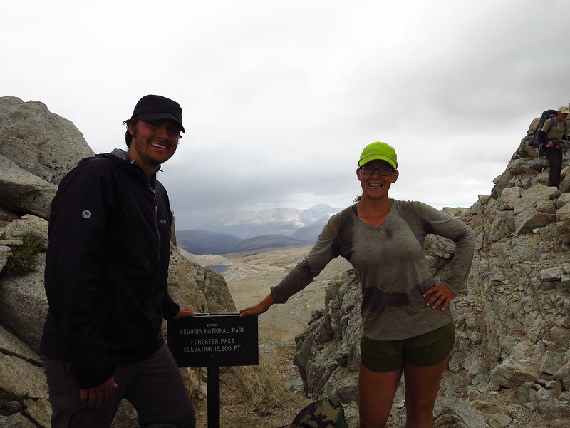 alice and russell atop forester pass with sign
