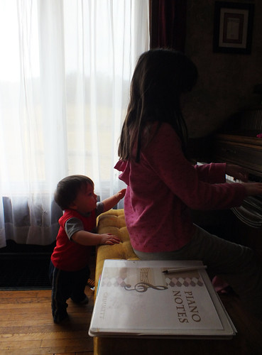 Jack pats the beat while Julia plays piano.