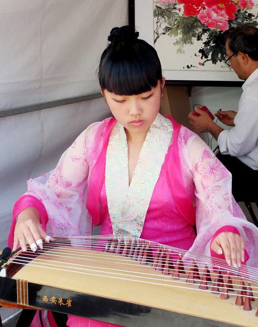 Girl Playing Chinese Instrument