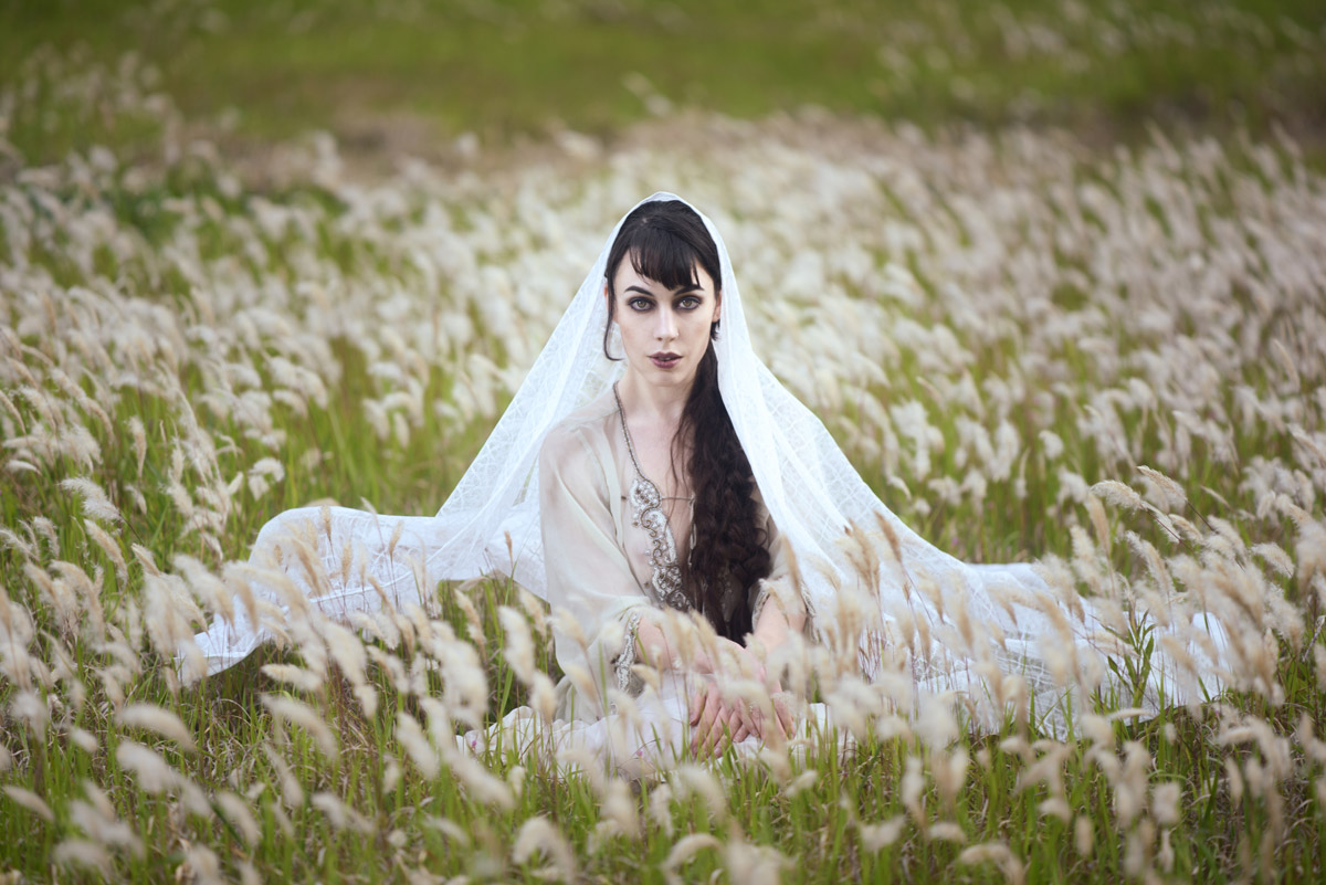 Gestalta photographed by Akiomi Kuroda. Dark haired model with white head dress in Japan.