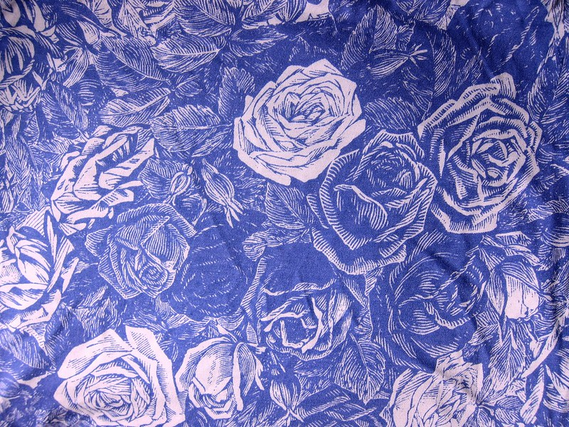 Purple and white rose print rayon/lycra knit from Mood