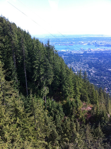 Going in the cable car down Grouse Mountain, with the Grouse Grind in the foreground and Vancouver in the background