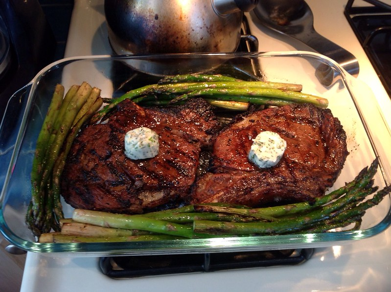 Steak, herb butter and asparagus