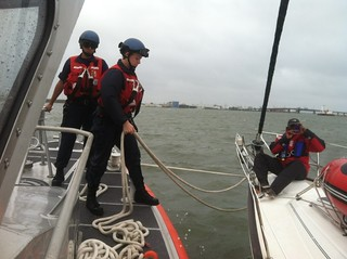 Crew members from Coast Guard Station Cape May assist boaters who are aboard a 44-foot sailboat offshore from Cape May, N.J., Saturday, Oct. 12, 2013. The Coast Guard's 45-foot Response Boat - Medium crew was already underway when they spotted the boaters stranded in the heavy weather and towed them to safety. (U.S. Coast Guard photo by Fireman Michael Deugwillo)