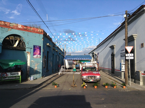 Under blue skies the blue tarp goes up on Calle Abasolo @ Oaxaca 10.2013