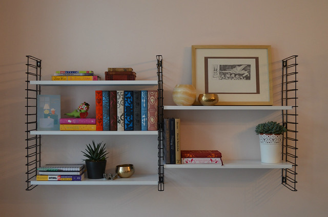 berlin apartment_living room wall shelves with books