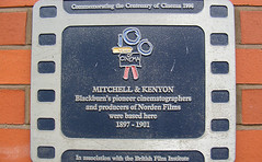 Photo of Sagar Mitchell and James Kenyon film cell plaque