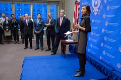 U.S. Ambassador to the U.S. Mission to the United Nations in Geneva Pamela Hamamoto introduces U.S. Secretary of State John Kerry - flanked by Christopher Wilson, U.S. Deputy Chief of Mission to the World Trade Organization, Ambassador Keith Harper of the U.S. Delegation to the United Nations Human Rights Council, and Permanent Representative of the United States to the Conference on Disarmament and U.S. Special Representative for Biological and Toxin Weapons Convention (BWC) Issues Robert Wood - to her staff during before the Secretary addressed them during a visit to the mission in Geneva, Switzerland, on January 26, 2015. [State Department photo/ Public Domain]