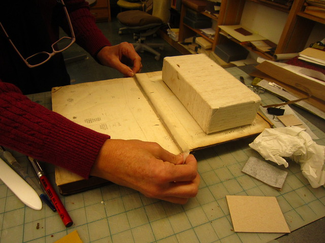 Applying Japanese paper to repair the broken internal hinge