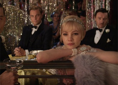 Tom and Gatsby flanking Carrie Mulligan as Daisy