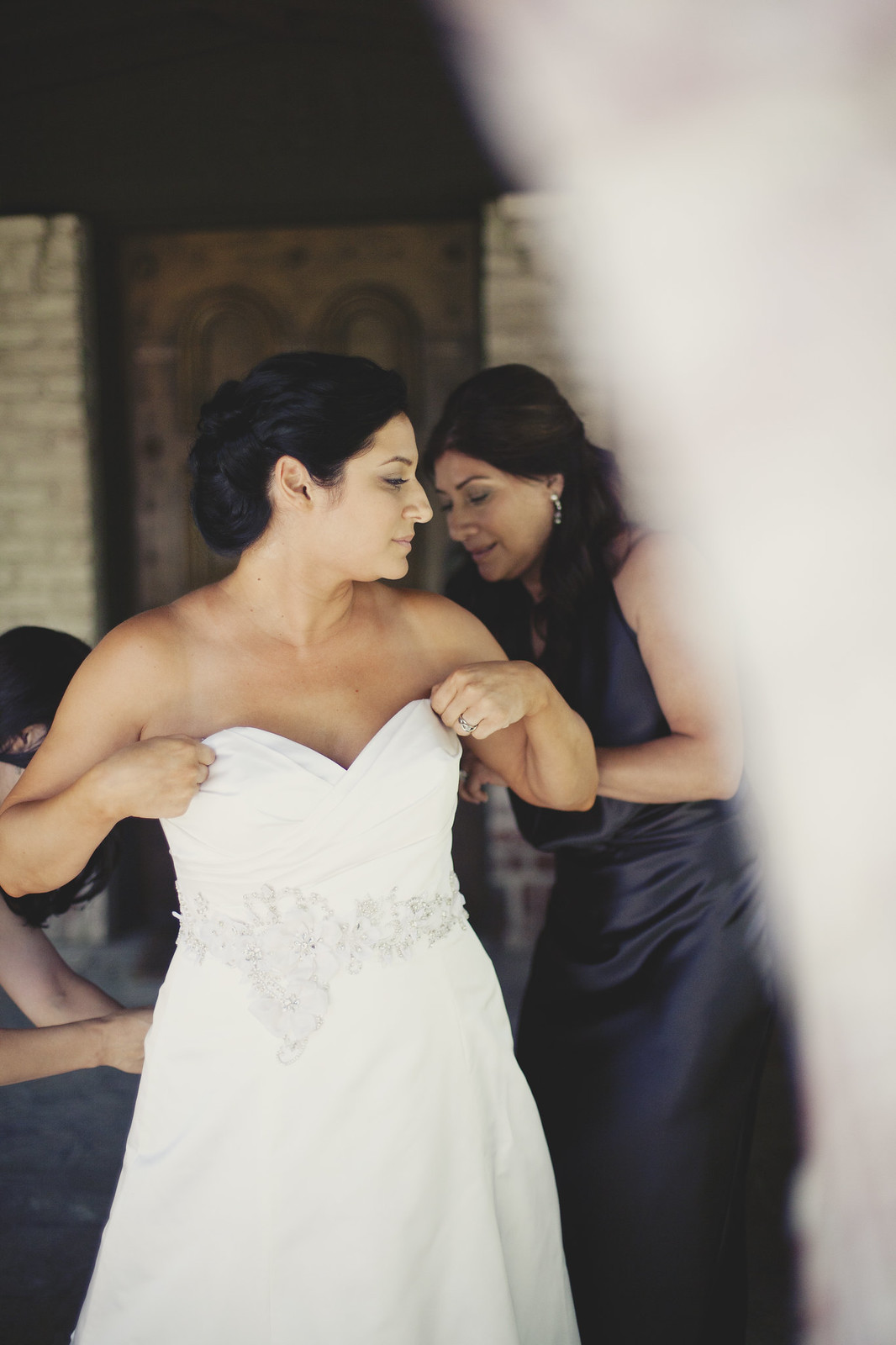 Mother Helping Her Daughter Get Ready For Her Wedding
