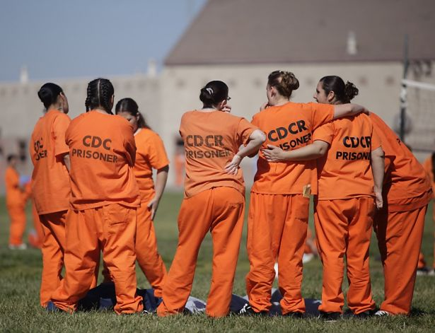 women in the ohio reformatory prison stand affectionately with each other