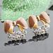 Small photo of Bruin legering diamanten oorbellen