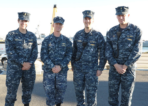 Ensign Dolph Eich, Ensign Charles Hasenbank, Ensign Kelly Reightler, and Cmdr. Timothy Wilke