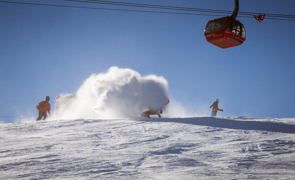 snowboarder carving under peak to peak express whistler blackcomb