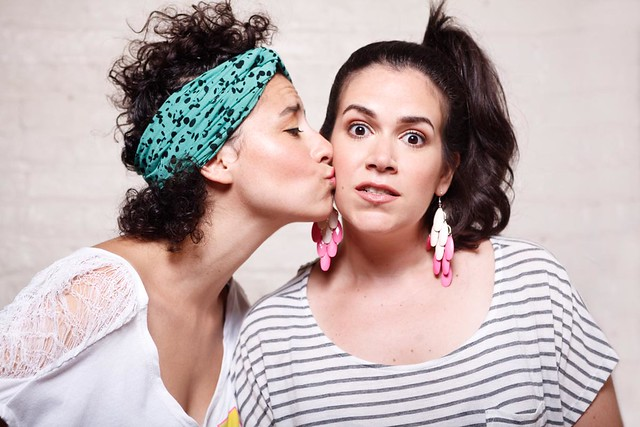 Ilana Glazer, left, kisses Abbi Jacobson on the cheek