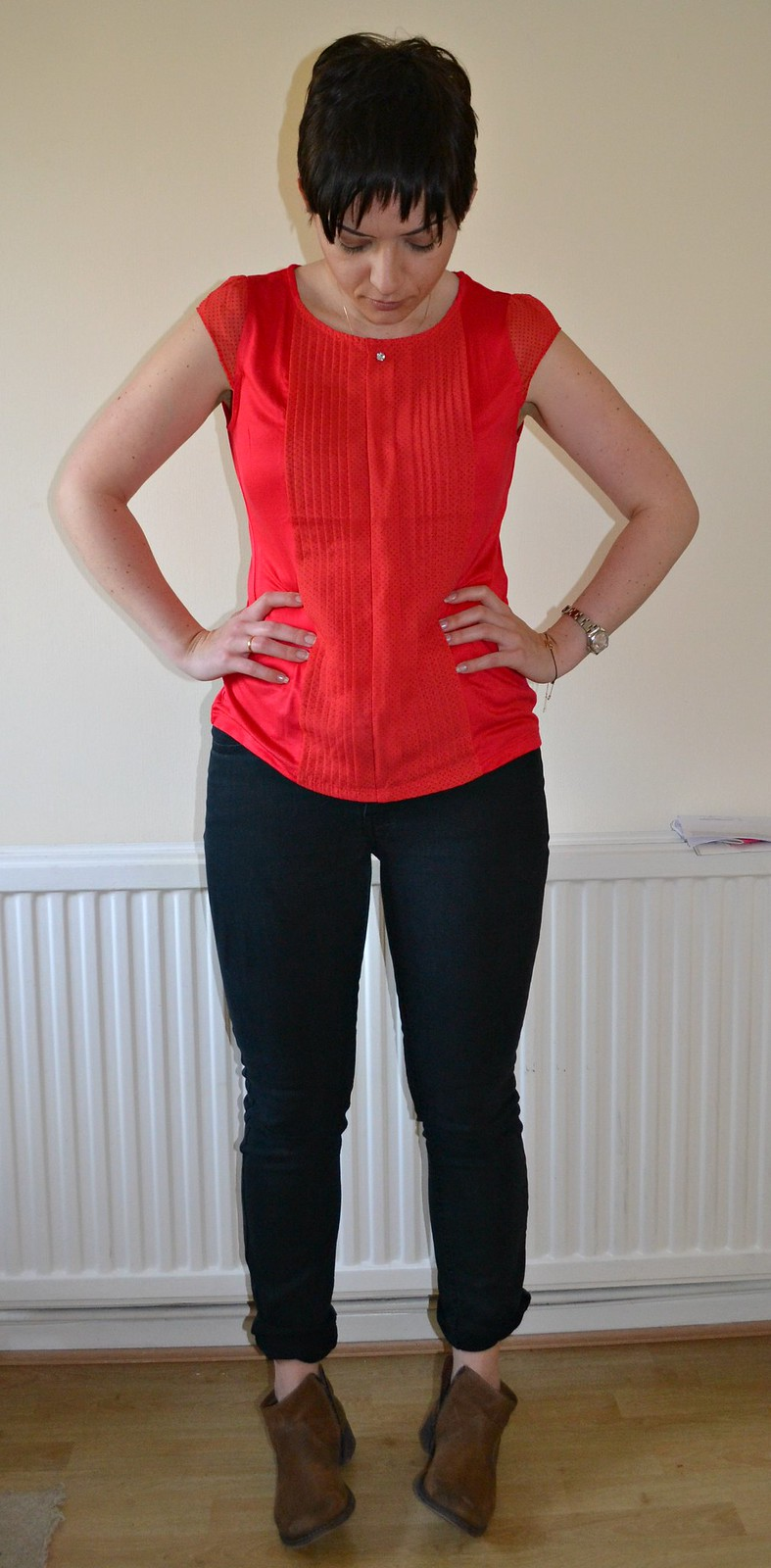 red top and black jeans