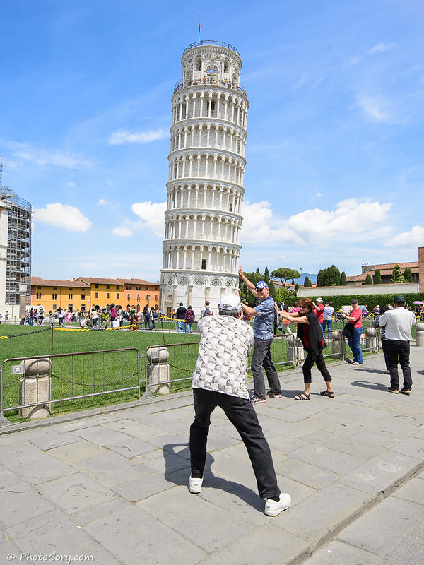Pushing the Tower of Pisa in Italy