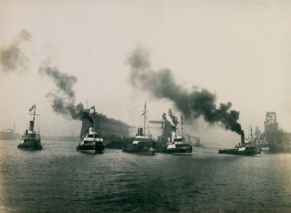 Tug boats towing the world's largest floating dock