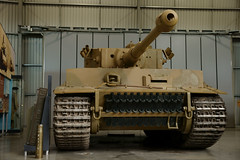 construction equipment(0.0), bulldozer(0.0), combat vehicle(1.0), military vehicle(1.0), weapon(1.0), vehicle(1.0), tank(1.0), self-propelled artillery(1.0), churchill tank(1.0), land vehicle(1.0), military(1.0),
