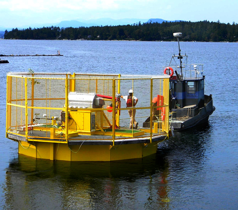 Buoy Profiling System is being towed to the IOS dock for final testing; Paul Macoun aboard the buoy.